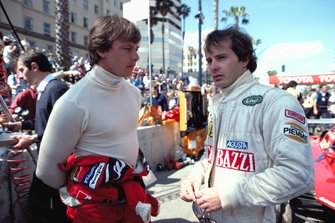Didier Pironi and Gilles Villeneuve talk in the Ferrari pit