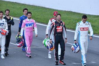 Sergio Perez, Racing Point, Romain Grosjean, Haas F1 and Nicholas Latifi, Williams Racing walk along the track