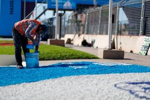 Painter paints the track
