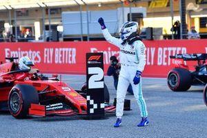 Valtteri Bottas, Mercedes AMG F1, celebrates after taking Pole Position as Sebastian Vettel, Ferrari