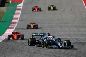 Lewis Hamilton, Mercedes AMG F1 W10, leads Charles Leclerc, Ferrari SF90, Lando Norris, McLaren MCL34, Sebastian Vettel, Ferrari SF90, and Daniel Ricciardo, Renault F1 Team R.S.19