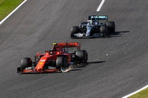 Charles Leclerc, Ferrari SF90, leadsLewis Hamilton, Mercedes AMG F1 W10, as he trails sparks from his damaged front wing