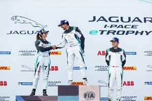 Ahmed Bin Khanen, Saudi Racing, 1st position, Célia Martin, Viessman Jaguar eTROPHY Team Germany, 2nd position, Yaqi Zhang, Team China, 3rd position, on the podium. Bin Khanen, Martin shake hands