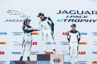 Ahmed Bin Khanen, Saudi Racing, 1st position, Célia Martin, Viessman Jaguar eTROPHY Team Germany, 2nd position, Yaqi Zhang, Team China, 3rd position, on the podium. Bin Khanen, Martin shake hands
