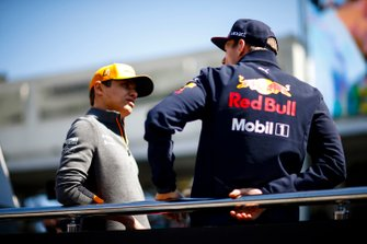 Lando Norris, McLaren, talks with Max Verstappen, Red Bull Racing, in the drivers parade
