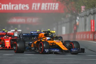 Carlos Sainz Jr., McLaren MCL34, leads Lance Stroll, Racing Point RP19, Charles Leclerc, Ferrari SF90, and the remainder of the field