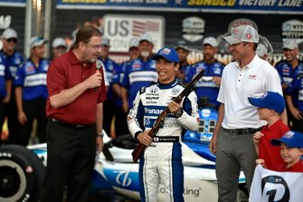 Takuma Sato, Rahal Letterman Lanigan Racing Honda celebrates winning pole with rifle