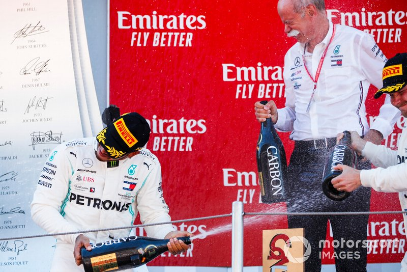 Lewis Hamilton, Mercedes AMG F1, 1st position, Dr Dieter Zetsche, CEO, Mercedes Benz, and Valtteri Bottas, Mercedes AMG F1, 2nd position, celebrate on the podium with Champagne