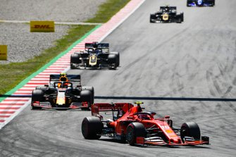 Charles Leclerc, Ferrari SF90, leads Pierre Gasly, Red Bull Racing RB15, and Romain Grosjean, Haas F1 Team VF-19