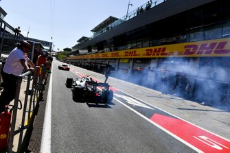 Car of Valtteri Bottas, Mercedes AMG W10 smokes in the pit lane