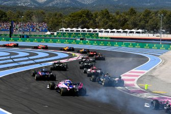 Charles Leclerc, Ferrari SF90, leads Max Verstappen, Red Bull Racing RB15, Carlos Sainz Jr., McLaren MCL34, Lando Norris, McLaren MCL34, Sebastian Vettel, Ferrari SF90, Pierre Gasly, Red Bull Racing RB15, Antonio Giovinazzi, Alfa Romeo Racing C38, Daniel Ricciardo, Renault F1 Team R.S.19, and Nico Hulkenberg, Renault F1 Team R.S. 19, and the remainder of the field on the opening lap