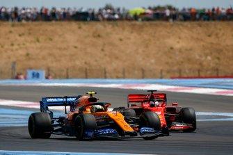 Lando Norris, McLaren MCL34, leads Sebastian Vettel, Ferrari SF90