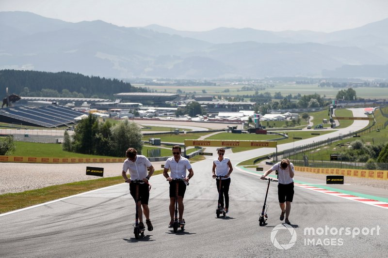 Lando Norris, McLaren walks the track with his team on a scooter