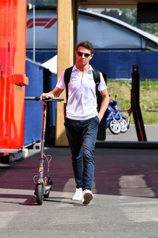Lando Norris, McLaren with a scooter in the paddock