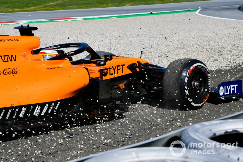 Carlos Sainz Jr., McLaren MCL34, runs through a gravel trap