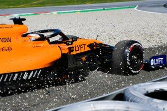 Carlos Sainz Jr., McLaren MCL34, runs through a gravel trap