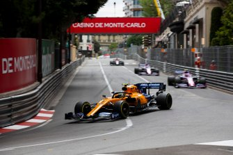 Lando Norris, McLaren MCL34, leads Lance Stroll, Racing Point RP19