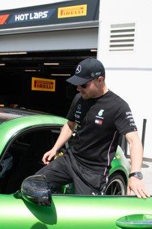 Valtteri Bottas, Mercedes AMG F1, enters a Hot Laps car