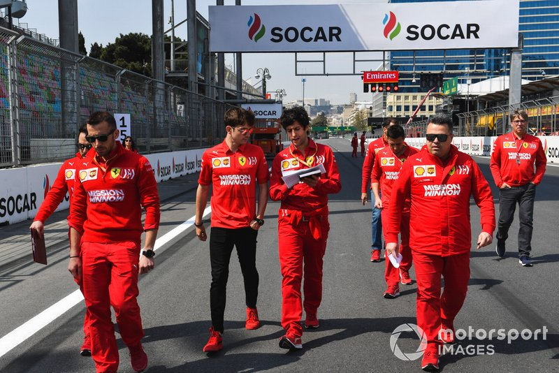 Charles Leclerc, Ferrari walks the track with his engineers