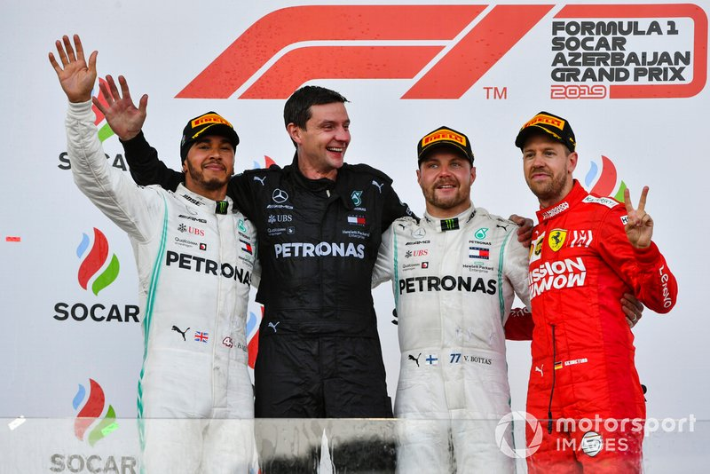 Lewis Hamilton, Mercedes AMG F1, the Mercedes Constructors trophy delegate, Valtteri Bottas, Mercedes AMG F1, 1st position, and Sebastian Vettel, Ferrari, 3rd position, on the podium