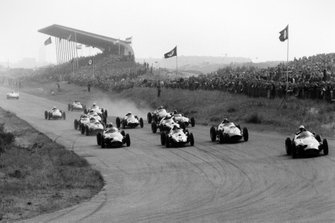 Jo Bonnier, BRM P25, leads Harry Schell, BRM P25, Masten Gregory, Cooper T51-Climax, Tony Brooks, Ferrari Dino 246, Jack Brabham, Cooper T51-Climax, Jean Behra, Ferrari Dino 246, Graham Hill, Lotus 16-Climax, and Stirling Moss, Cooper T51-Climax, at the start