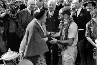Stirling Moss, Vanwall congratulated by Aintree's owner, Mrs Mirabel Topham with Earl Howe, President of the BRDC