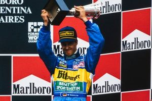 Third place Michael Schumacher celebrates on the podium
