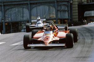 Gilles Villeneuve, Ferrari 126CK, leads Nigel Mansell, Lotus 87 Ford