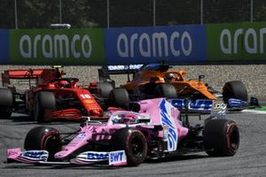 Sergio Perez, Racing Point RP20, leads as Charles Leclerc, Ferrari SF1000, battles with Carlos Sainz Jr., McLaren MCL35