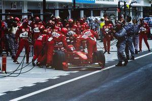 Eddie Irvine, Ferrari F300, retires in the pit lane