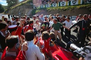 Jochen Rindt celebrates victory with wife Nina and team boss Colin Chapman