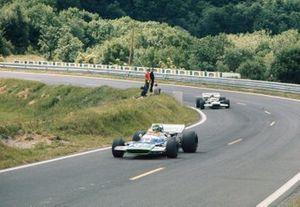 Henri Pescarolo, Matra MS120 leads Graham Hill, Lotus 49C Ford