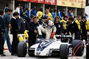 Hector Rebaque climbs out of his Brabham BT49 Ford in the pits