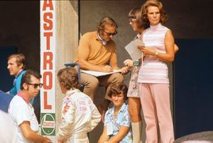 Lotus boss Colin Chapman with wife Hazel and family in the pits, next to Jochen Rindt, Lotus 72C Ford, who was killed in practice