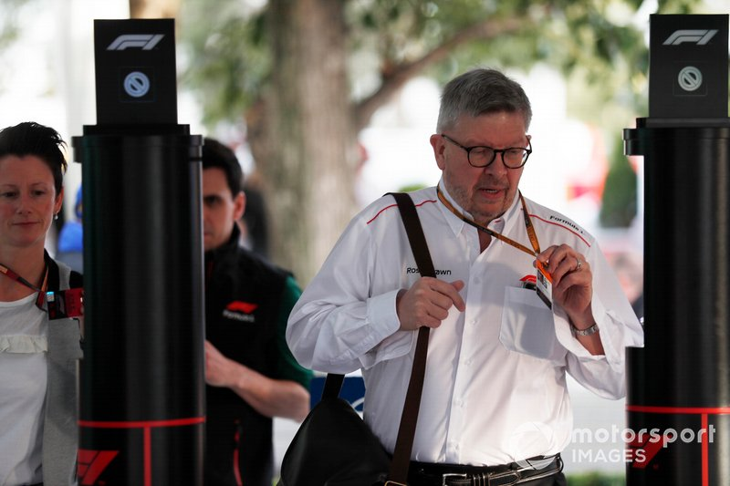 Ross Brawn, Managing Director of Motorsports, FOM, arrives in the paddocl