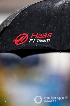 Rain falls on a Haas team umbrella