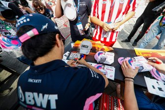 Sergio Perez, Racing Point signs autographs for fans