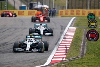 Valtteri Bottas, Mercedes AMG W10 leads Lewis Hamilton, Mercedes AMG F1 W10 and Sebastian Vettel, Ferrari SF90 on the formation lap
