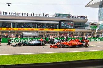Valtteri Bottas, Mercedes AMG W10, Lewis Hamilton, Mercedes AMG F1 W10, and Sebastian Vettel, Ferrari SF90,