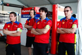 Members of the Mahindra Racing team in the garage