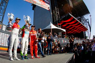 Winner Benito Guerra celebrates on the podium with runner up Loic Duval and ROC Skills Challenge winner Sebastian Vettel