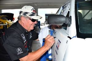 Jim Dentici signs the restored 1988 Acura Integra
