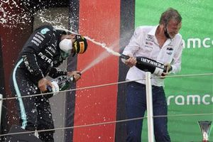 Lewis Hamilton, Mercedes, 1st position, and the Mercedes trophy delegate spray Champagne on the podium