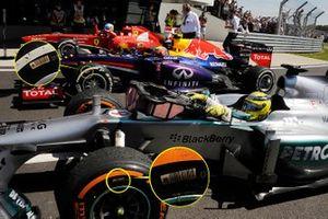 Nico Rosberg, Mercedes AMG F1 W04, Mark Webber, Red Bull Racing RB9 y Fernando Alonso, Ferrari F138. El círculo muestra que las ruedas izquierdas se han instalado en el lado derecho del coche.