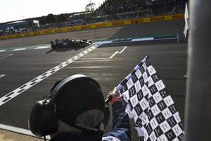 Lewis Hamilton, Mercedes W12, passes the chequered flag to take pole at the end of Qualifying