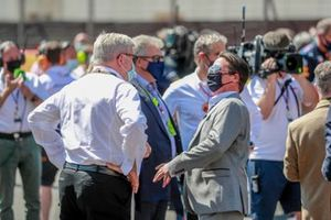 Ross Brawn, Managing Director of Motorsports, on the grid with guests