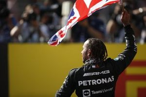 Lewis Hamilton, Mercedes, 1st position, celebrates with a Union flag after the race