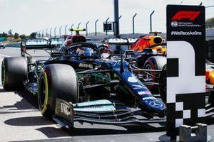 Valtteri Bottas, Mercedes W12, arrives in Parc Ferme after securing pole
