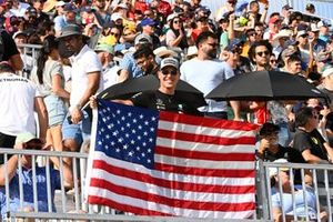 A fan with a US flag in a grandstand