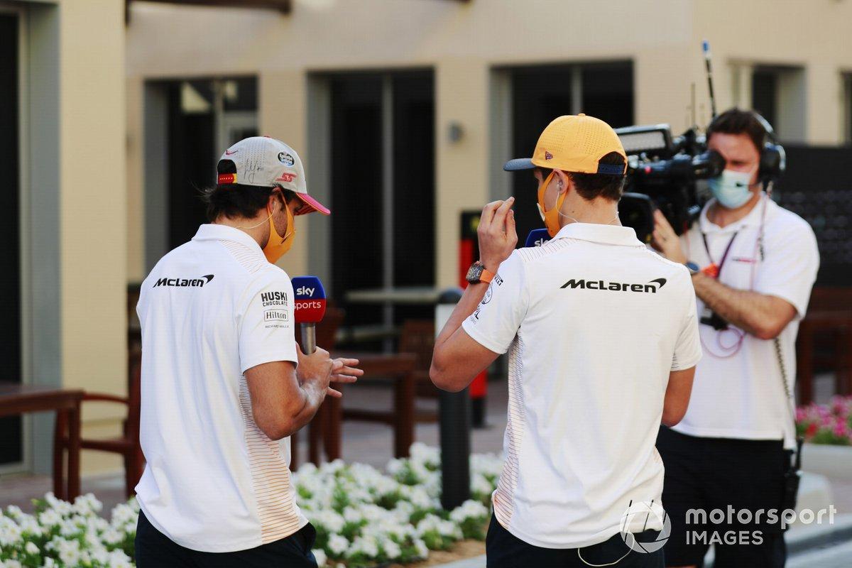 Lando Norris, McLaren and Carlos Sainz Jr., McLaren, are filmed in the paddock